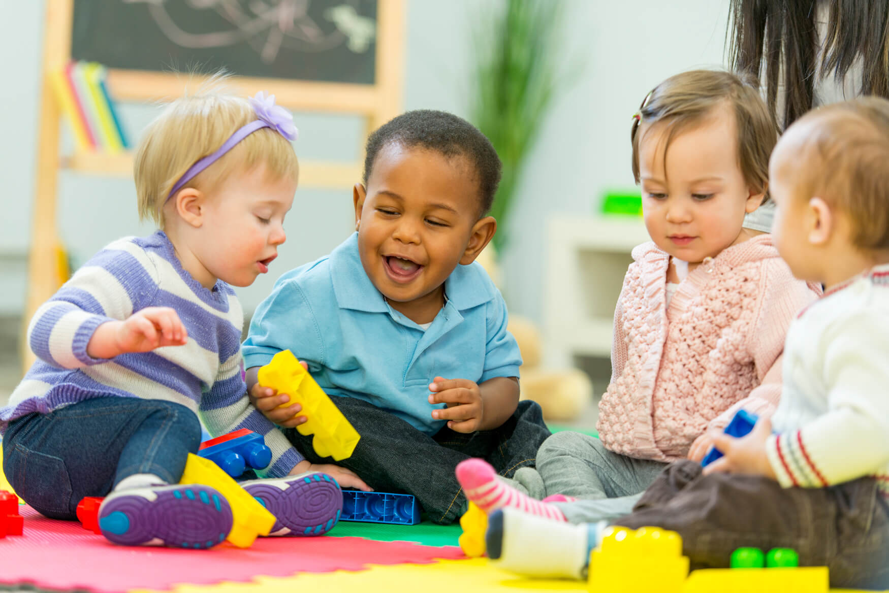 infants-playing-with-blocks