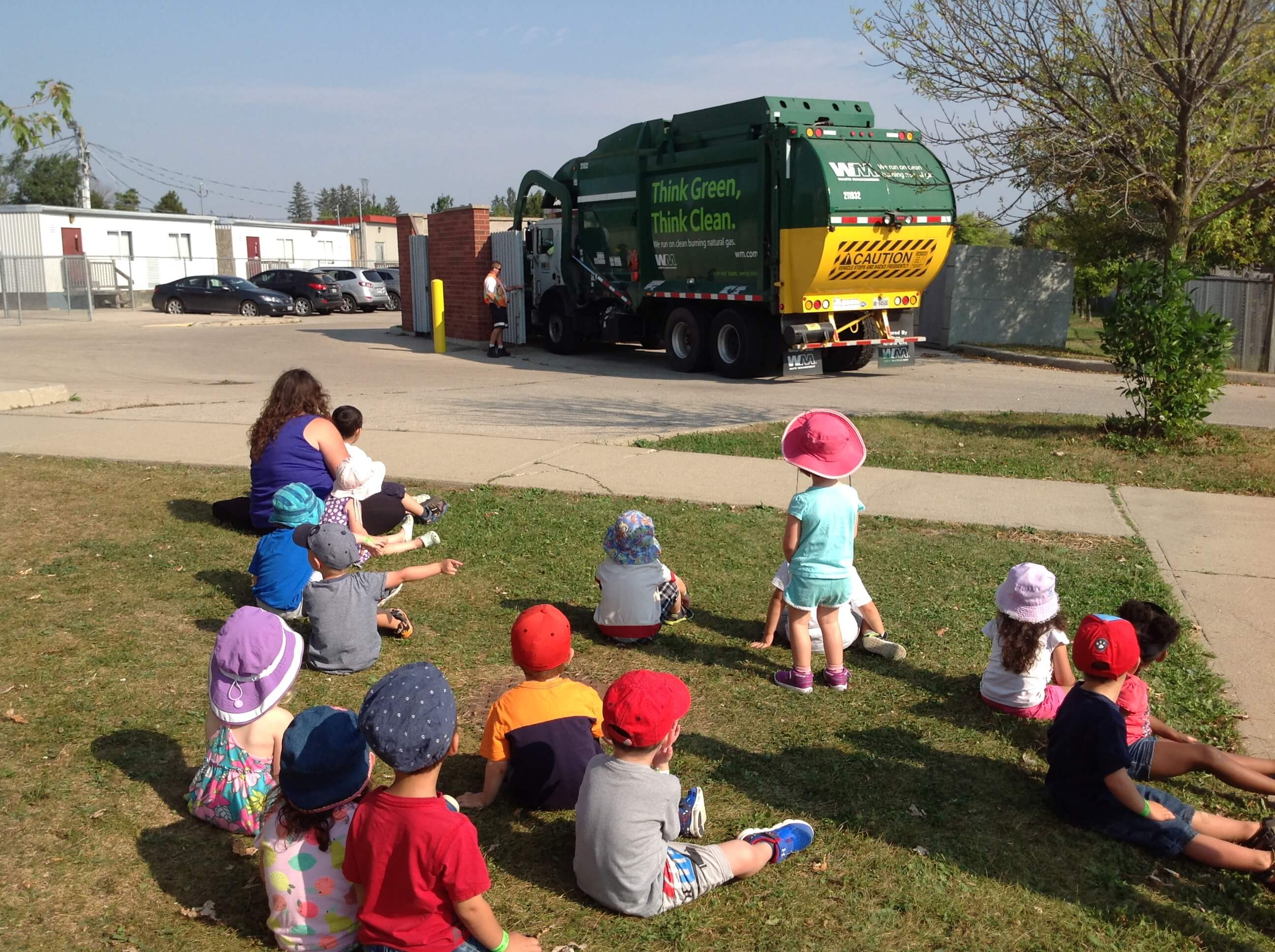 children watching a garbage truck