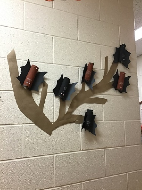 The bats the children made hanging on the wall