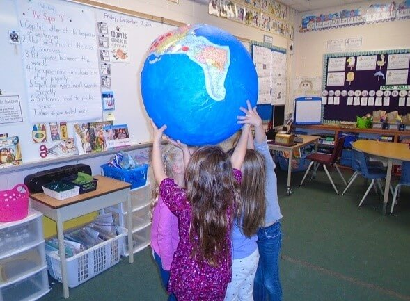 holding up the globe we made